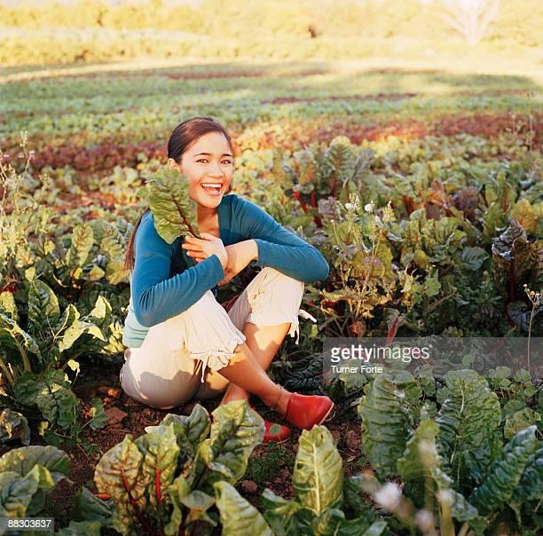 Smiling woman in lettuce field