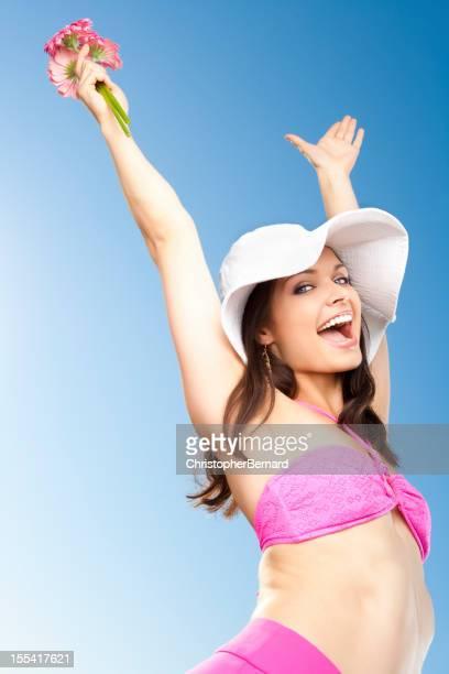 Smiling woman in pink bikini