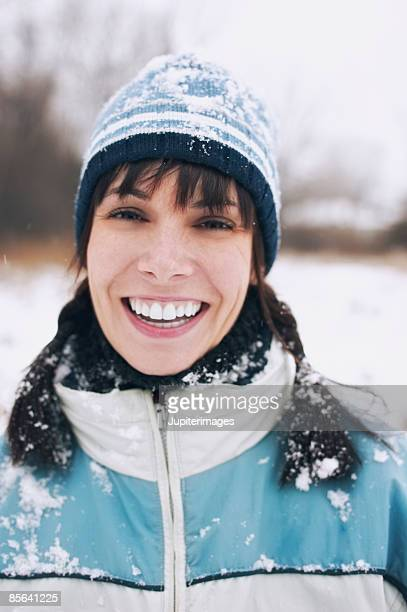 Smiling woman in snow