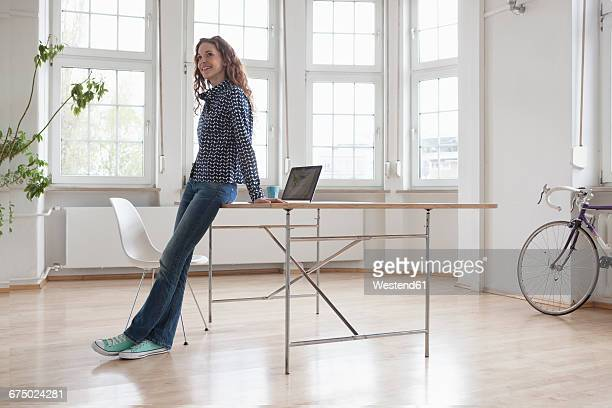 Smiling woman in sparse office
