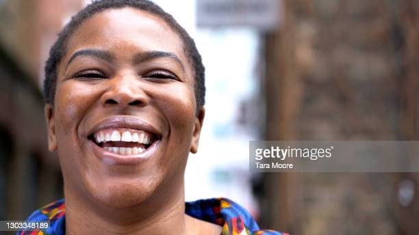 smiling woman in street - candid stock pictures, royalty-free photos & images