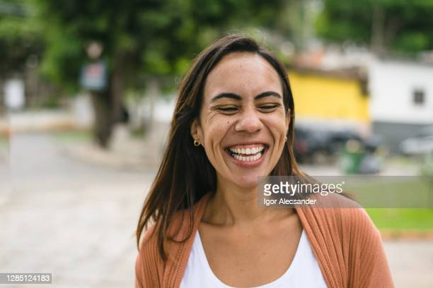 smiling woman in the city - latin american and hispanic ethnicity stock pictures, royalty-free photos & images
