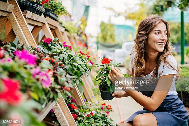 Smiling woman in the garden center