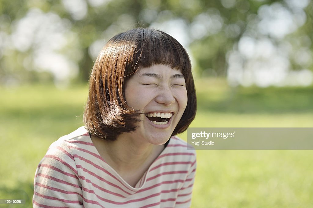 Smiling Woman in the green : Stock Photo