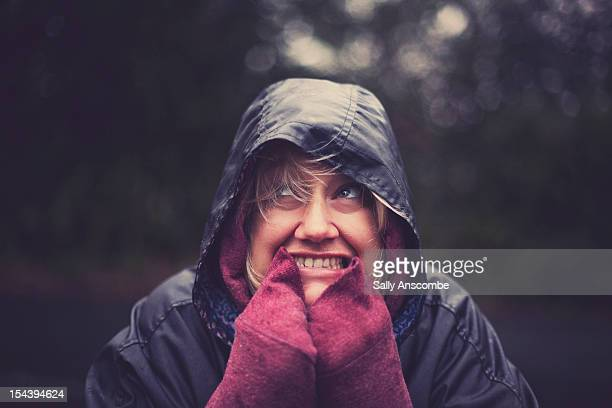 Smiling woman in the rain