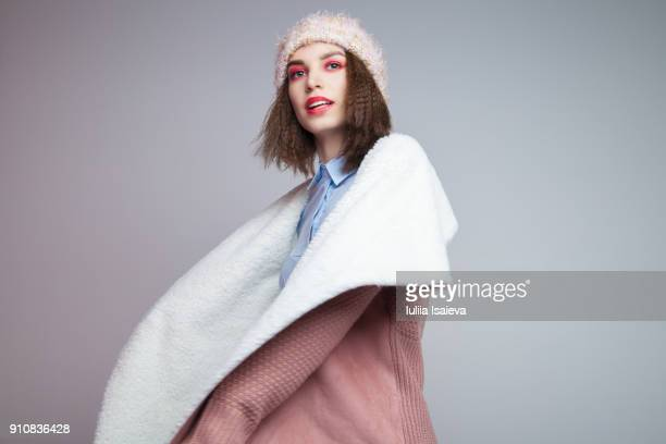 smiling woman in warm clothes - multi colored coat stock photos and pictures