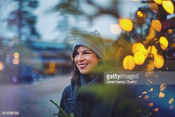 Smiling Woman In Warm Clothing Against Sky