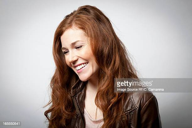 Smiling woman laughing indoors