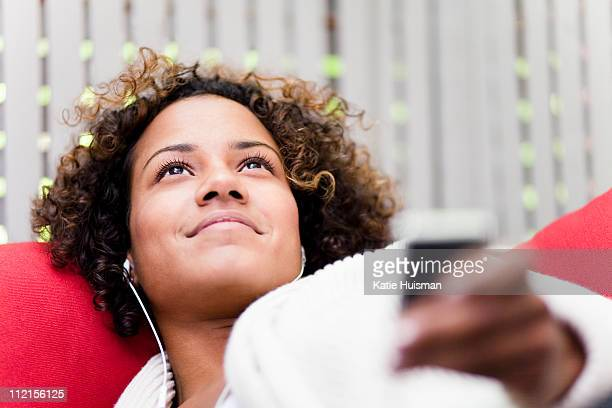 Smiling woman listening to mp3 player