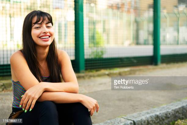 smiling woman looking at camera - laughing stock pictures, royalty-free photos & images