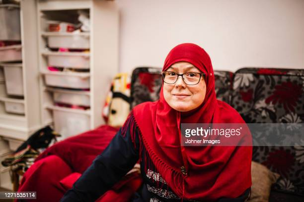 smiling woman looking at camera - västra götaland county stock pictures, royalty-free photos & images