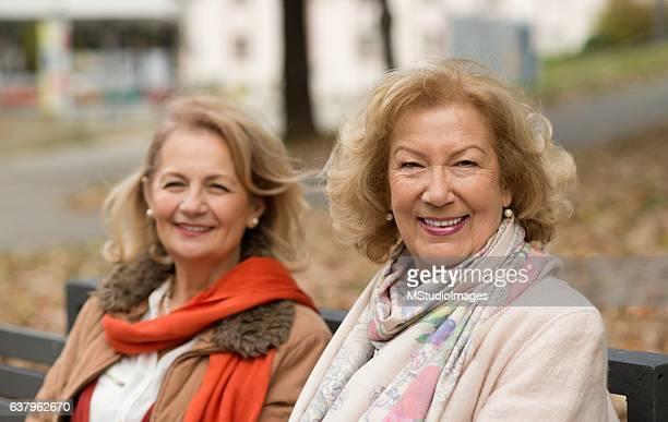 Smiling woman looking at camera.