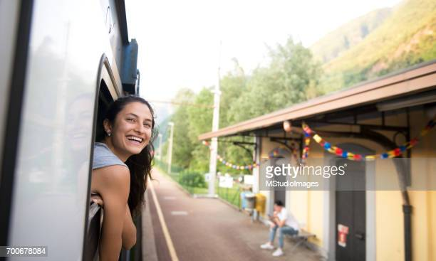 smiling woman looking at the view from train. - reportaje imágenes stock pictures, royalty-free photos & images