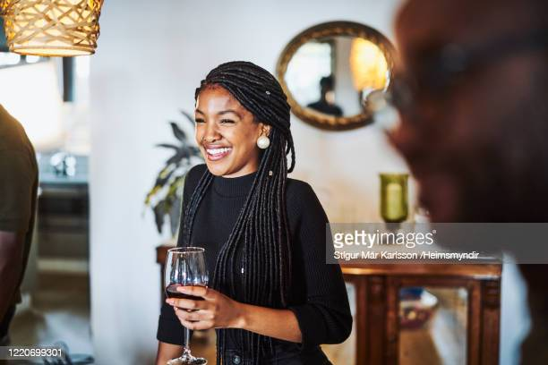 smiling woman looking away while having wine - wine stock pictures, royalty-free photos & images