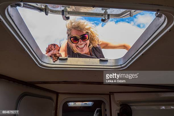 Smiling woman looking into bow of boat