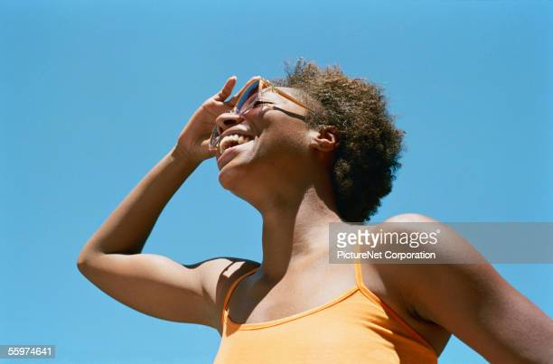 smiling woman looking to the horizon - heat stock pictures, royalty-free photos & images