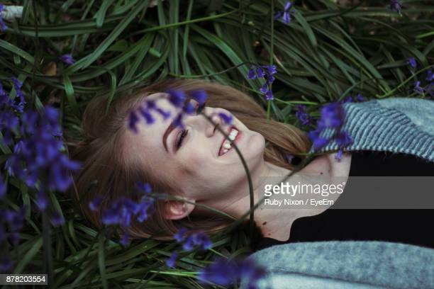 Smiling Woman Lying Down On Field