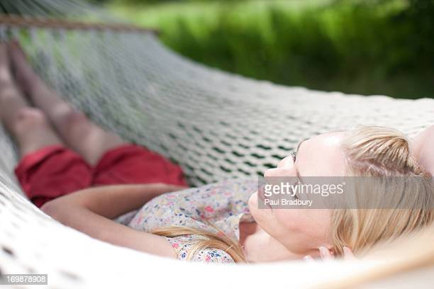 Smiling woman lying in hammock