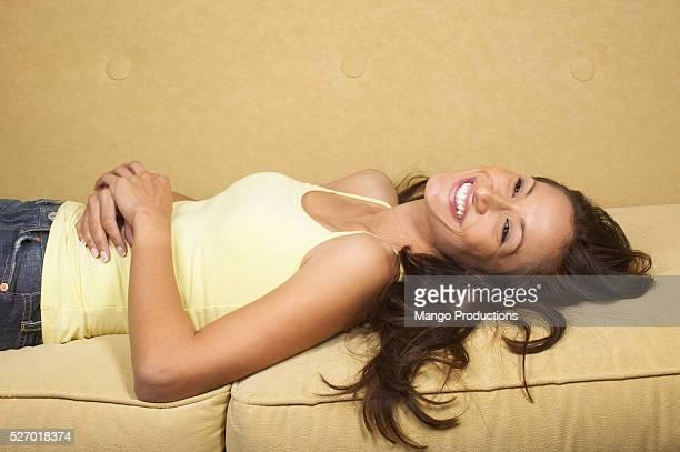 Smiling Woman Lying on Sofa