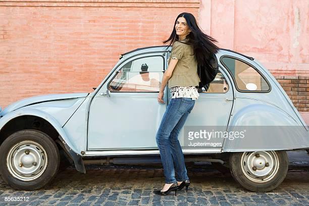 Smiling woman next to car
