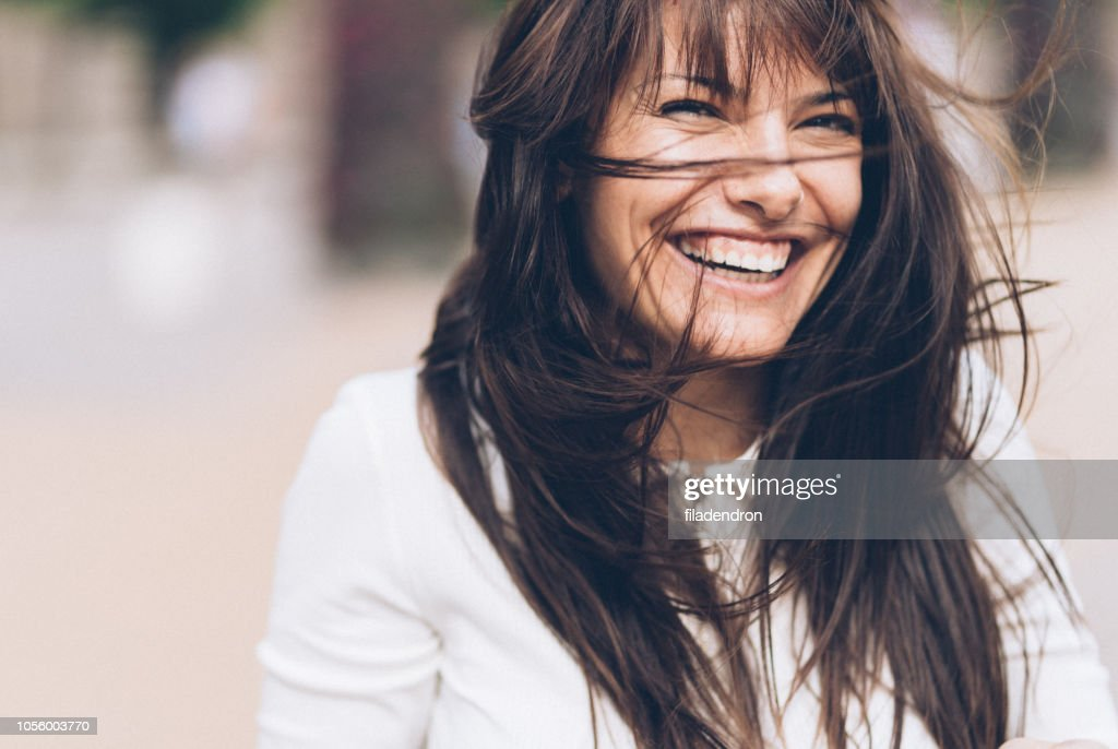 Smiling woman on a windy day : Stock Photo