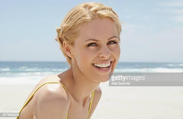 smiling woman on beach, cape town, south africa - blond frauen strand stock-fotos und bilder