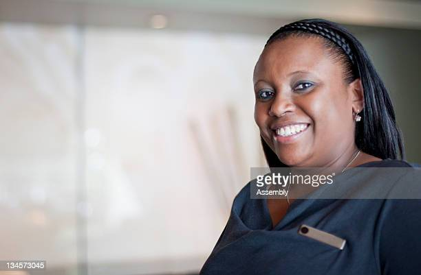 A smiling woman on hotel staff.