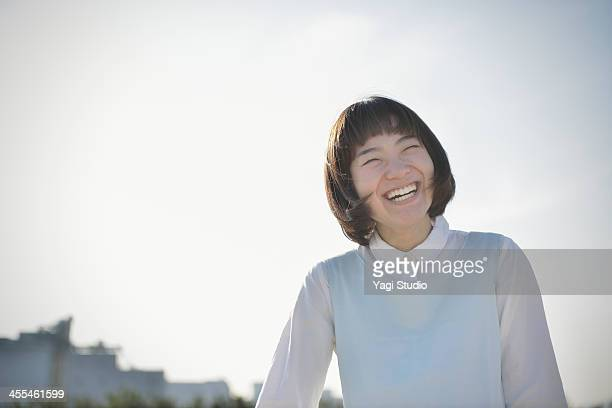smiling woman on the beach - smiling ストックフォトと画像