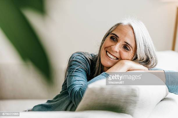 Smiling woman on the couch at home
