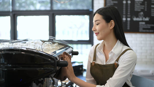 Smiling Woman Operating Espresso In Cafe