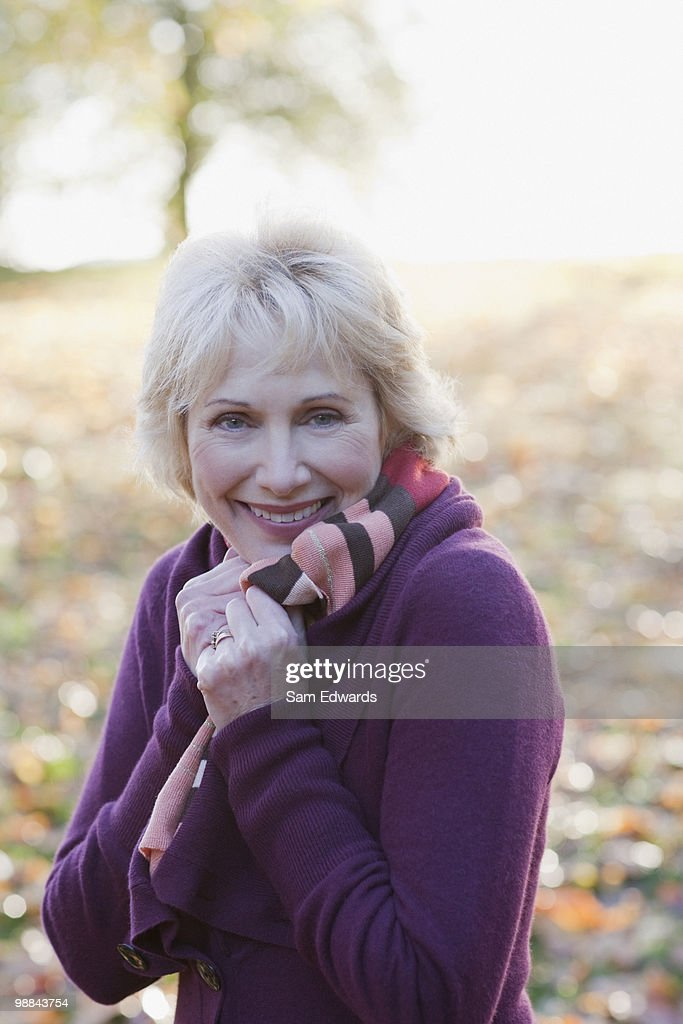 Smiling woman outdoors in autumn : Stock Photo