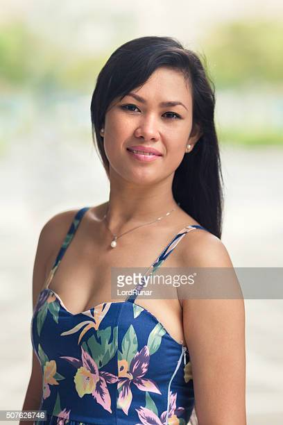 smiling woman outdoors in summer - beautiful filipino women stock photos and pictures