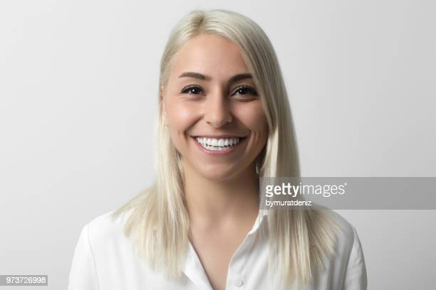Smiling woman over gray background