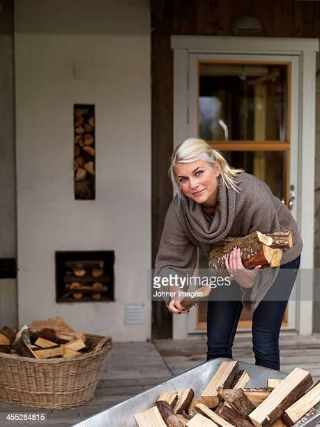 Smiling woman picking firewood