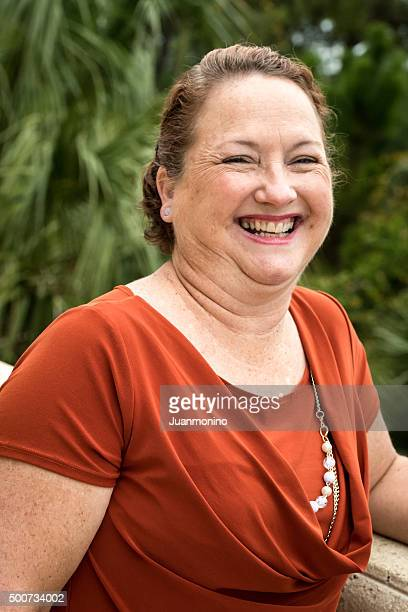 smiling woman - older redhead stock pictures, royalty-free photos & images