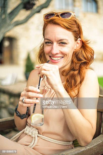 smiling woman - tonic water stock pictures, royalty-free photos & images