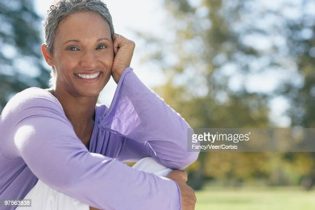 smiling woman - purple shirt stock photos and pictures
