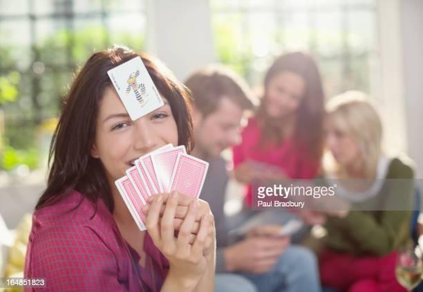 Smiling woman playing card game