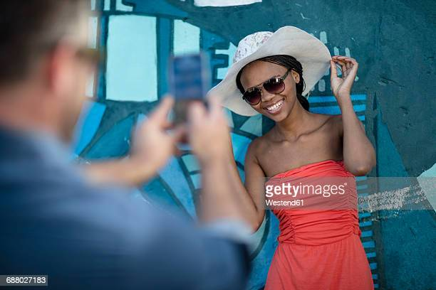 Smiling woman posing for a photograph
