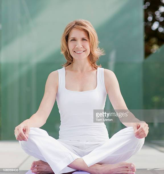 Smiling woman practicing yoga