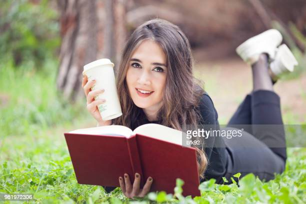 Smiling woman reading a book.