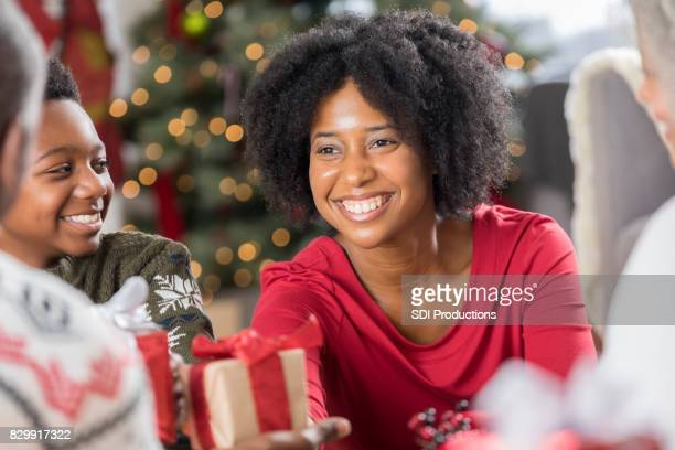 Smiling woman receives Christmas gift
