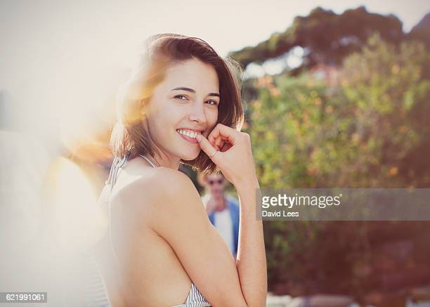 Smiling woman relaxing at pool party