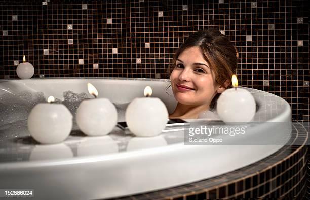 Smiling woman relaxing in bath