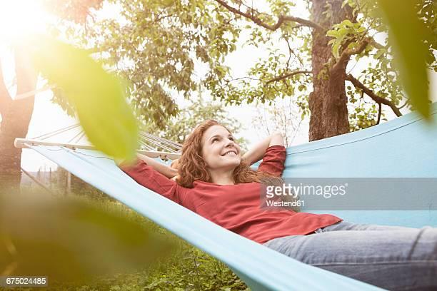 Smiling woman relaxing in hammock