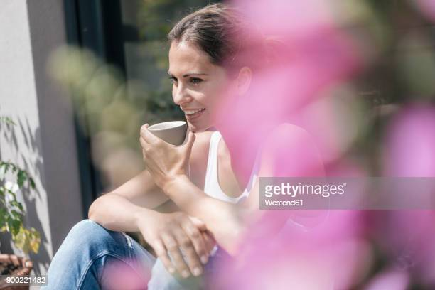 Smiling woman relaxing on balcony