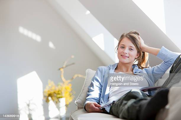 Smiling woman relaxing on sofa
