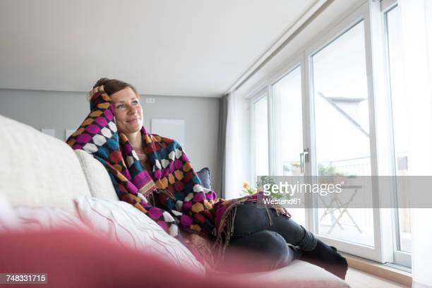 Smiling woman relaxing on the couch
