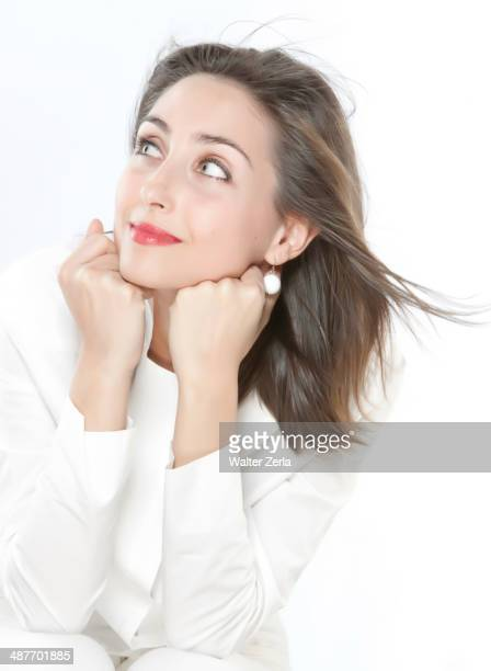 Smiling woman resting chin on hands