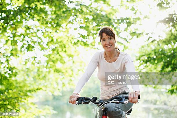 Smiling woman riding bicycle